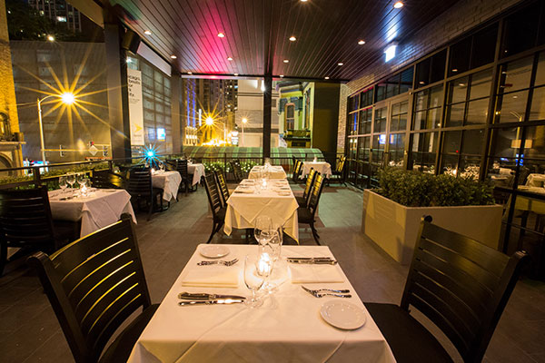 Lights light up the outdoor seating area